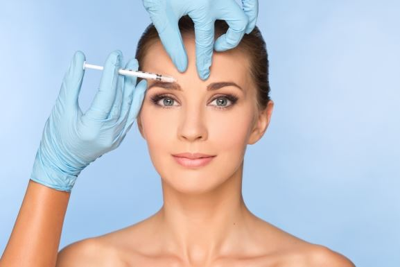 Woman Getting Botox Above Eyebrow